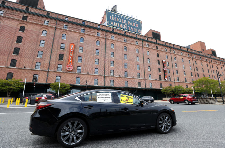 BALTIMORE, MARYLAND - MAY 14: Concession workers protest from their cars outside of Camden Yards before a protest on May 14, 2020 in Baltimore, Maryland. The group is calling for the Baltimore Orioles baseball team to pay the workers unemployment insurance benefits due to the fact the start of the MLB season has been delayed due to the Covid-19 pandemic. (Photo by Rob Carr/Getty Images)