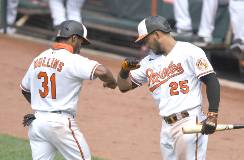 BALTIMORE, MD - AUGUST 02: Cedric Mullins #31 of the Baltimore Orioles celebrates scoring a run with Anthony Santander #25 on a Hanser Alberto #57 (not pictured) double in the seventh inning during a baseball game against the Tampa Bay Rays on August 2, 2020 at Oriole Park at Camden Yards in Baltimore, Maryland. (Photo by Mitchell Layton/Getty Images)
