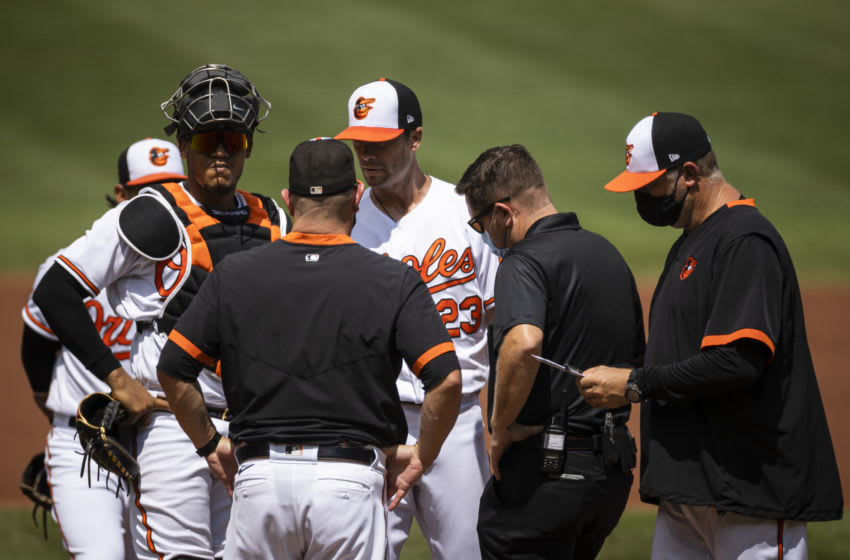 BALTIMORE, MD - AUGUST 23: Wade LeBlanc #23 of the Baltimore Orioles is relieved from pitching duties against the Boston Red Sox during the first inning at Oriole Park at Camden Yards on August 23, 2020 in Baltimore, Maryland. (Photo by Scott Taetsch/Getty Images)