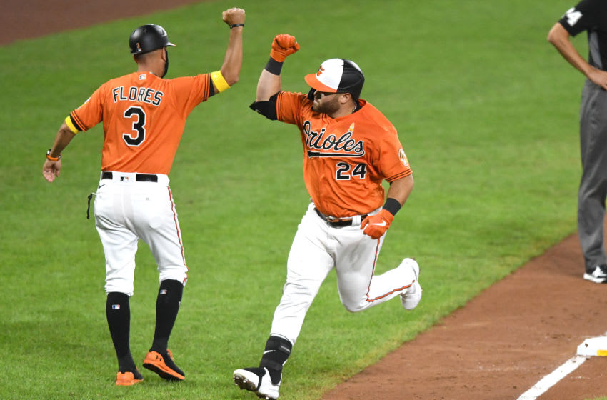 BALTIMORE, MD - SEPTEMBER 05: DJ Stewart #24 of the Baltimore Orioles celebrates a solo home with third base coach Jose Flores #3 in the seventh inning during a baseball game against the New York Yankees at Oriole Park at Camden Yards on September 5, 2020 in Baltimore, Maryland. (Photo by Mitchell Layton/Getty Images)