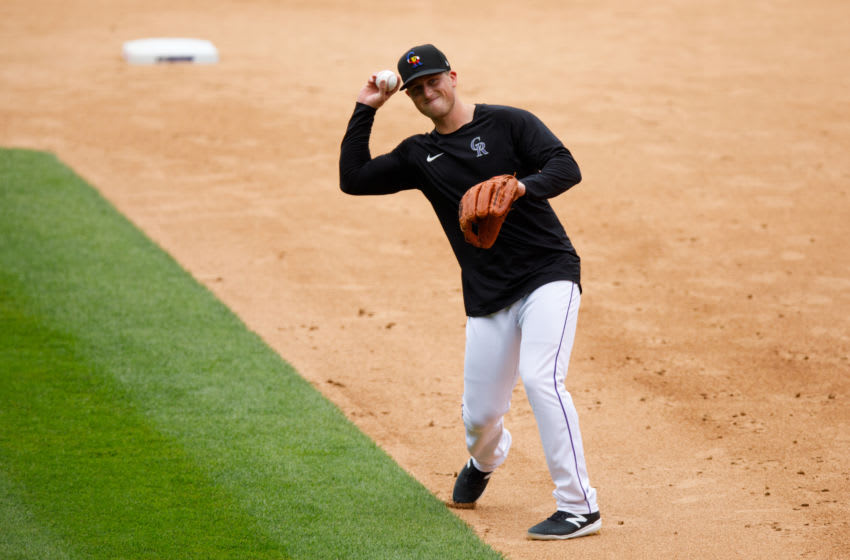 DENVER, CO - JULY 4: Tyler Nevin #72 of the Colorado Rockies throws to first base after fielding a ground ball during Major League Baseball Summer Workouts at Coors Field on July 4, 2020 in Denver, Colorado. (Photo by Justin Edmonds/Getty Images)