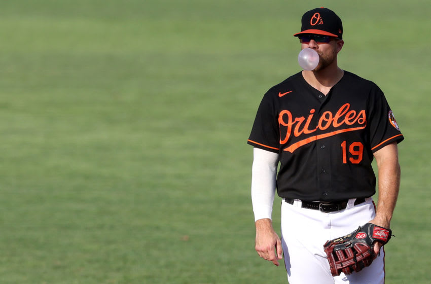 BALTIMORE, MARYLAND - AUGUST 05: First basemen Chris Davis #19 of the Baltimore Orioles blows a bubble during the third inning against the Miami Marlins during game one of a doubleheader at Oriole Park at Camden Yards on August 05, 2020 in Baltimore, Maryland. (Photo by Rob Carr/Getty Images)