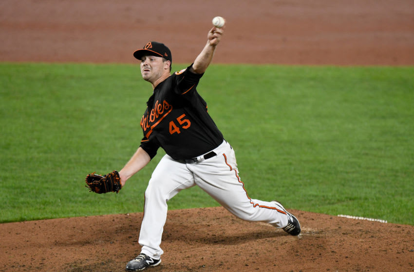 BALTIMORE, MD - AUGUST 14: Keegan Akin #45 of the Baltimore Orioles pitches in his MLB debut against the Washington Nationals at Oriole Park at Camden Yards on August 14, 2020 in Baltimore, Maryland. (Photo by G Fiume/Getty Images)