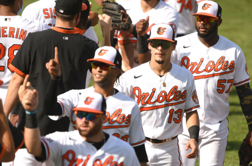BALTIMORE, MD - SEPTEMBER 06: Andrew Velazquez #13 of the Baltimore Orioles celebrates a win after a game baseball game against the New York Yankees at Oriole Park at Camden Yards on September 6, 2020 in Baltimore, Maryland. (Photo by Mitchell Layton/Getty Images)