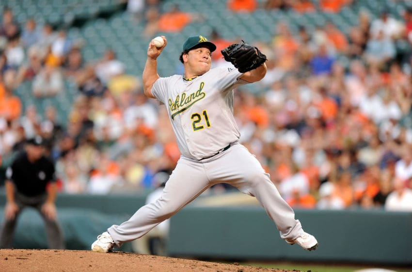 BALTIMORE, MD - JULY 28: Bartolo Colon #21 of the Oakland Athletics pitches against the Baltimore Orioles at Oriole Park at Camden Yards on July 28, 2012 in Baltimore, Maryland. (Photo by G Fiume/Getty Images)