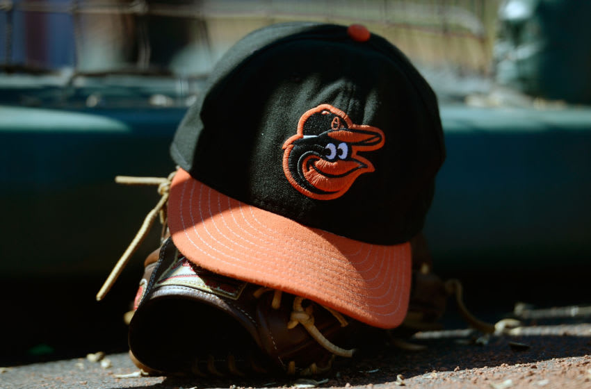 SAN FRANCISCO, CA - AUGUST 10: A general view of a cap and glove belonging to a Baltimore Orioles player sitting on the steps of the dugout against the San Francisco Giants at AT&T Park on August 10, 2013 in San Francisco, California. (Photo by Thearon W. Henderson/Getty Images)