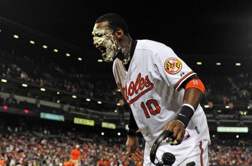 BALTIMORE, MD - AUGUST 13: Adam Jones #10 of the Baltimore Orioles reacts after being hit with a pie after the Orioles defeated the New York Yankees 5-3 during a baseball game at Oriole Park at Camden Yards on August 13, 2014 in Baltimore, Maryland. (Photo by Patrick McDermott/Getty Images)