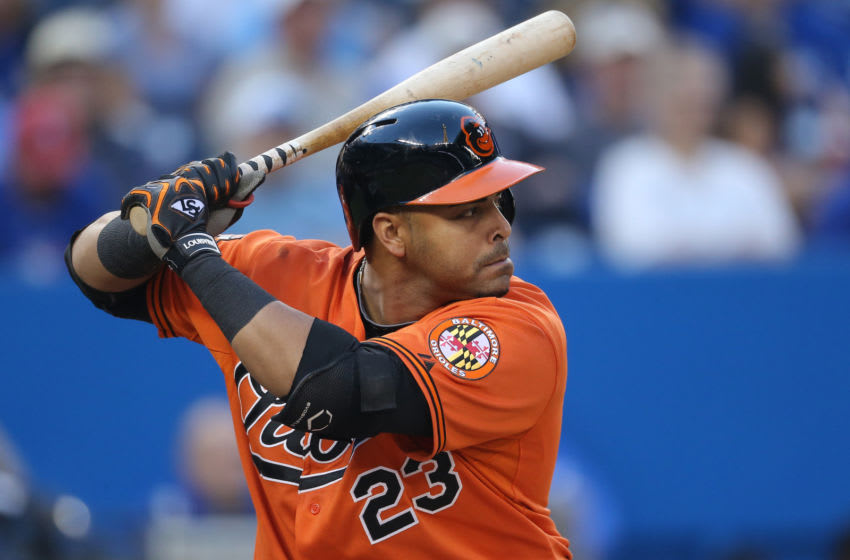 TORONTO, CANADA - SEPTEMBER 27: Nelson Cruz #23 of the Baltimore Orioles bats during MLB game action against the Toronto Blue Jays on September 27, 2014 at Rogers Centre in Toronto, Ontario, Canada. (Photo by Tom Szczerbowski/Getty Images)