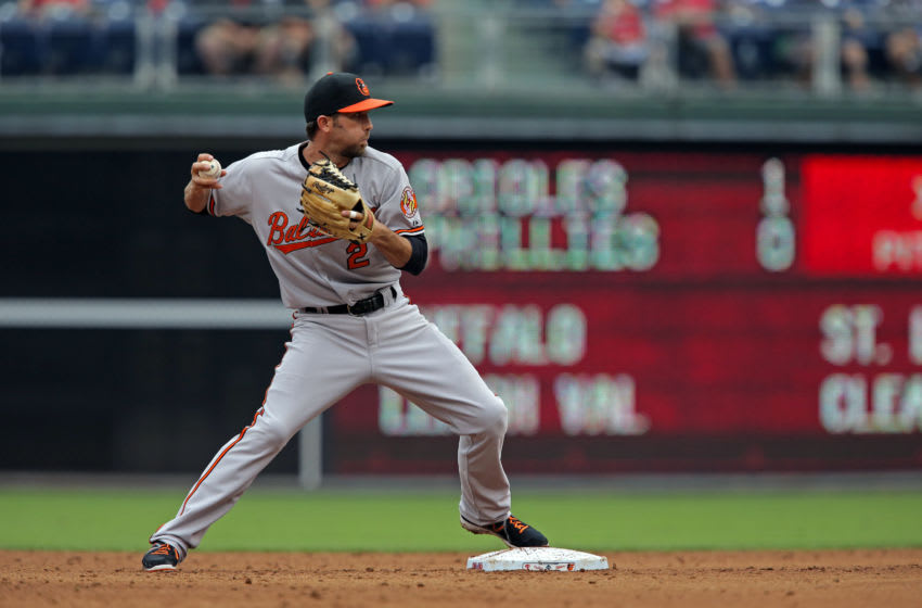 PHILADELPHIA - JUNE 18: J.J. Hardy #2 of the Baltimore Orioles turns a double play in the second inning during a game against the Philadelphia Phillies at Citizens Bank Park on June 18, 2015 in Philadelphia, Pennsylvania. (Photo by Hunter Martin/Getty Images)