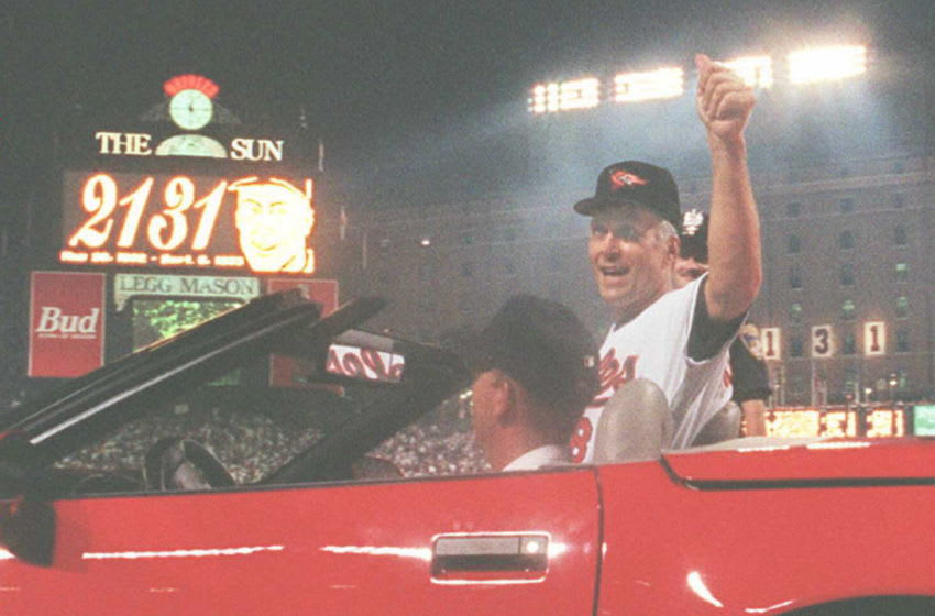 BALTIMORE, MD - SEPTEMBER 7: Cal Ripken Jr. of the Baltimore Orioles waves to the crowd as he is driven around the field during a post-game ceremony where he was honored for setting a new record of 2,131 consecutive games played in a game against the California Angels 06 September. Ripken broke the record set by Lou Gehrig of the New York Yankees in the 1930's, and the Orioles defeated the Angels, 4-2. AFP PHOTO (Photo credit should read BRIAN BAHR/AFP via Getty Images)