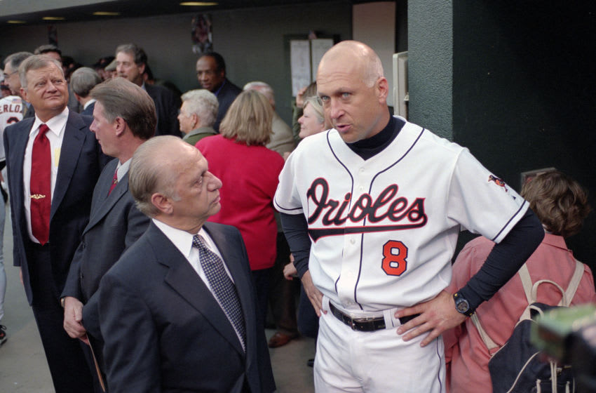 BALTIMORE, MD - OCTOBER 6: Owner Peter Angelos talks with Cal Ripken Jr. #8 of the Baltimore Orioles who is be honored by the Orioles organization prior to the final game of his Major League baseball career against the Boston Red Sox October 6, 2001 at Oriole Park at Camden Yards in Baltimore, Maryland. Cal Ripken Jr played for the Orioles from 1981-2001. (Photo by Focus on Sport/Getty Images)