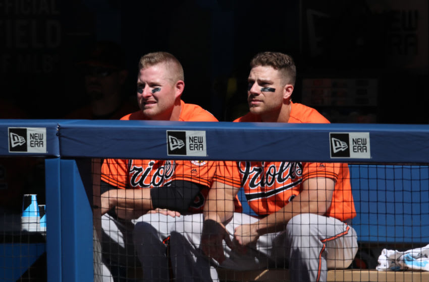 TORONTO, CANADA - JUNE 11: Mark Trumbo #45 of the Baltimore Orioles and Chris Davis #19 look on from the top step of the dugout during MLB game action against the Toronto Blue Jays on June 11, 2016 at Rogers Centre in Toronto, Ontario, Canada. (Photo by Tom Szczerbowski/Getty Images)