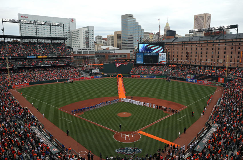 BALTIMORE, MD - APRIL 03: The Baltimore Orioles and the Toronto Blue Jays stand during the national anthem before their Opening Day game at Oriole Park at Camden Yards on April 3, 2017 in Baltimore, Maryland (Photo by Patrick Smith/Getty Images)