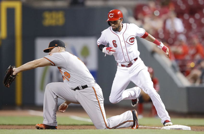 CINCINNATI, OH - APRIL 19: Billy Hamilton #6 of the Cincinnati Reds gets back to first base ahead of the throw to Chris Davis #19 of the Baltimore Orioles in the eighth inning of the game at Great American Ball Park on April 19, 2017 in Cincinnati, Ohio. The Orioles defeated the Reds 2-0. (Photo by Joe Robbins/Getty Images)