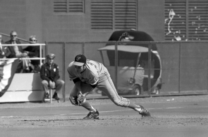 PITTSBURGH, PA - OCTOBER 14, 1971: Thirdbaseman Brooks Robinson #5 of the Baltimore Orioles can't handle the ground ball hit by firstbaseman Bob Robertson #7 of the Pittsburgh Pirates during the third inning of game five of the World Series on October 14, 1971 at Three Rivers Stadium in Pittsburgh, Pennsylvania. 711014-06 (Photo by: Ron Kuntz Collection/Diamond Images/Getty Images)