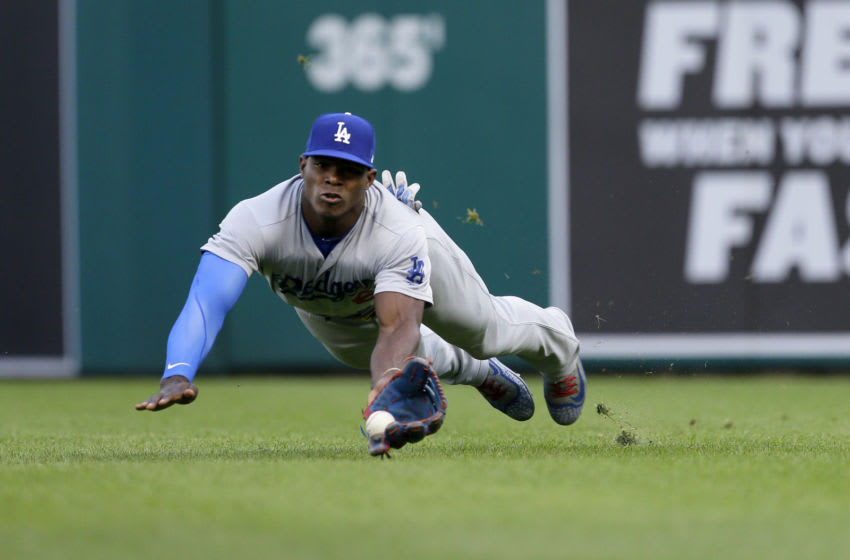 DETROIT, MI - AUGUST 18: Right fielder Yasiel Puig #66 of the Los Angeles Dodgers makes a diving catch on a fly ball hit by Nicholas Castellanos of the Detroit Tigers during the first inning at Comerica Park on August 18, 2017 in Detroit, Michigan. (Photo by Duane Burleson/Getty Images)