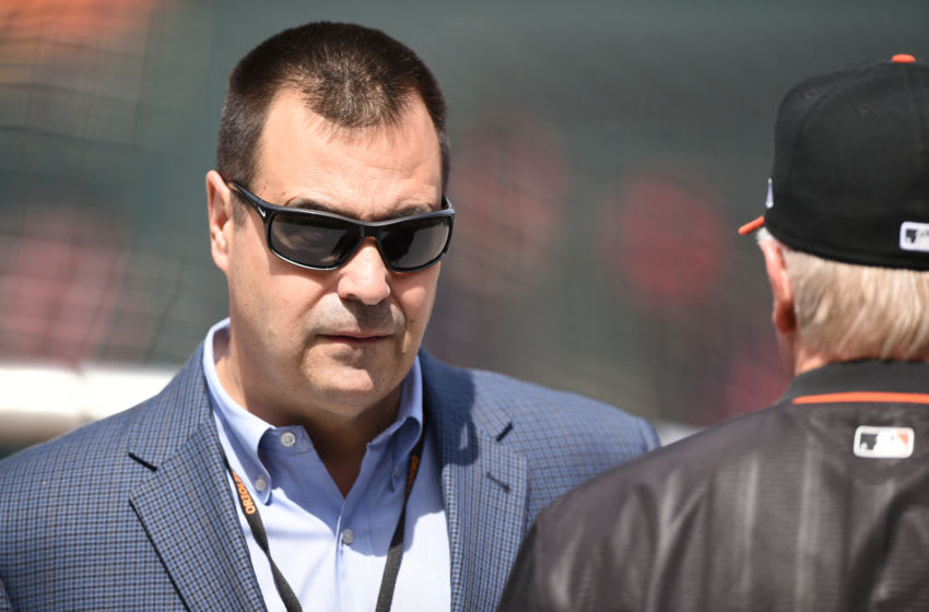 BALTIMORE, MD - APRIL 21: General manager Dan Duquette of the Baltimore Orioles talks with manager Buck Showalter #26 before a baseball game against the Cleveland Indians at Oriole Park at Camden Yards on April 21, 2018 in Baltimore, Maryland. (Photo by Mitchell Layton/Getty Images)