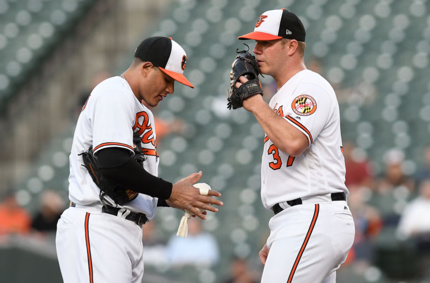 BALTIMORE, MD - MAY 08: Dylan Bundy #37 of the Baltimore Orioles talks with Manny Machado #13 during the first inning against the Kansas City Royals at Oriole Park at Camden Yards on May 8, 2018 in Baltimore, Maryland. (Photo by Greg Fiume/Getty Images)