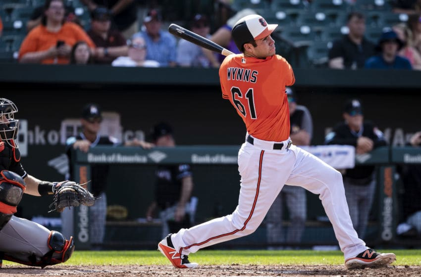 BALTIMORE, MD - JUNE 16: Austin Wynns #61 of the Baltimore Orioles singles during the third inning against the Miami Marlins at Oriole Park at Camden Yards on June 16, 2018 in Baltimore, Maryland. (Photo by Scott Taetsch/Getty Images)