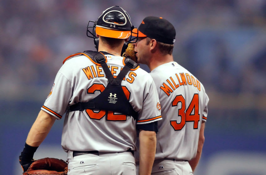 ST. PETERSBURG, FL - APRIL 06: Catcher Matt Wieters #32 and pitcher Kevin Millwood #34 of the Baltimore Orioles have a conversation at the mound against the Tampa Bay Rays during the home opener game at Tropicana Field on April 6, 2010 in St. Petersburg, Florida. (Photo by J. Meric/Getty Images)