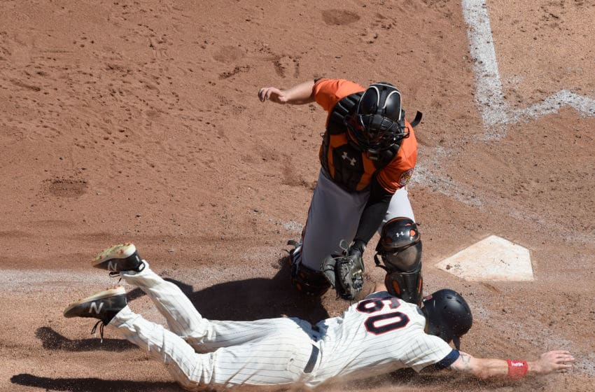MINNEAPOLIS, MN - JULY 7: Chance Sisco #15 of the Baltimore Orioles tags out Jake Cave #60 of the Minnesota Twins at home plate during the sixth inning of the game on July 7, 2018 at Target Field in Minneapolis, Minnesota. The Twins defeated the Orioles 5-4. (Photo by Hannah Foslien/Getty Images)