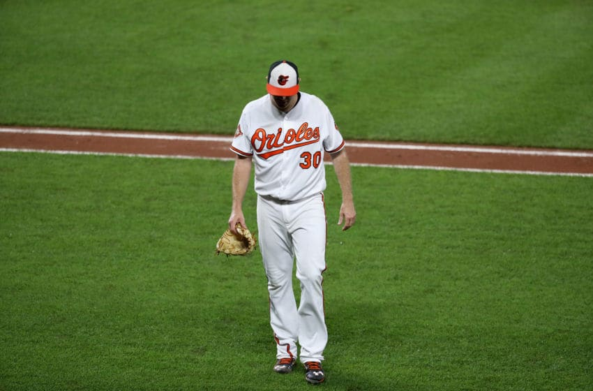 BALTIMORE, MD - AUGUST 03: Starting pitcher Chris Tillman #30 of the Baltimore Orioles leaves the game in the third inning against the Detroit Tigers at Oriole Park at Camden Yards on August 3, 2017 in Baltimore, Maryland. (Photo by Rob Carr/Getty Images)