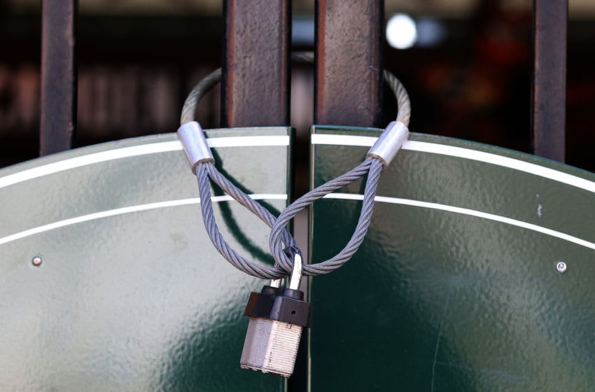 BALTIMORE, MARYLAND - MARCH 26: A lock is wrapped around a closed entrance at Oriole Park at Camden Yards on March 26, 2020 in Baltimore, Maryland. The Baltimore Orioles and New York Yankees Opening Day game scheduled for today, along with the entire MLB season, has been postponed due to the COVID-19 pandemic. (Photo by Rob Carr/Getty Images)