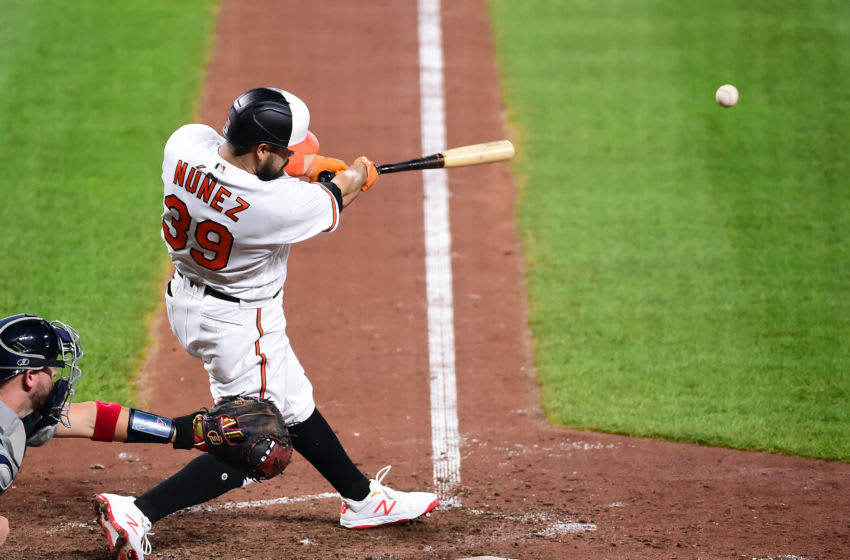 Sep 16, 2020; Baltimore, Maryland, USA; Baltimore Orioles first baseman Renato Nunez (39) hits a two run double in the sixth inning against the Atlanta Braves at Oriole Park at Camden Yards. Mandatory Credit: Evan Habeeb-USA TODAY Sports