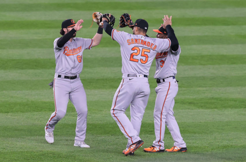 Apr 7, 2021; Bronx, New York, USA; Baltimore Orioles right fielder Anthony Santander (25) celebrates with center fielder Ryan McKenna (65) and center fielder Cedric Mullins (31) after their game against the New York Yankees at Yankee Stadium. Mandatory Credit: Vincent Carchietta-USA TODAY Sports