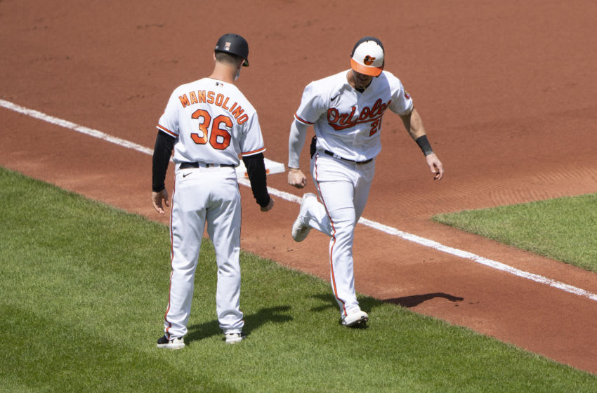 Apr 25, 2021; Baltimore, Maryland, USA; Balitmore Orioles third base coach Tony Mansolino (36) congratulates Baltimore Orioles right fielder Austin Hays (21) for hitting a home run during the second inning against the Oakland Athletics at Oriole Park at Camden Yards. Mandatory Credit: Gregory Fisher-USA TODAY Sports