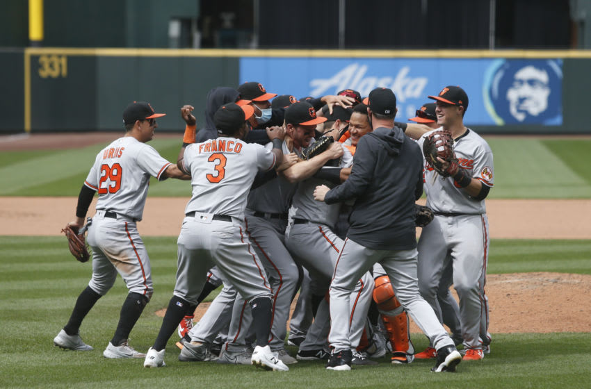 May 5, 2021; Seattle, Washington, USA; Baltimore Orioles players celebrate with Baltimore Orioles starting pitcher John Means (47) following a 6-0 no-hit victory against the Seattle Mariners at T-Mobile Park. Mandatory Credit: Joe Nicholson-USA TODAY Sports