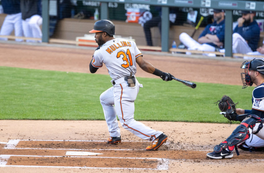 May 25, 2021; Minneapolis, Minnesota, USA; Baltimore Orioles center fielder Cedric Mullins (31) hits a two-RBI single during the second inning against the Minnesota Twins at Target Field. Mandatory Credit: Jordan Johnson-USA TODAY Sports