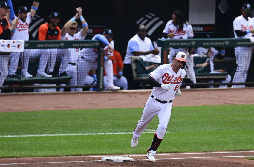 Jun 20, 2021; Baltimore, Maryland, USA; Baltimore Orioles dugout reacts as first baseman Trey Mancini (16) rounds the bases on his first inning home run against the Toronto Blue Jays at Oriole Park at Camden Yards. Mandatory Credit: Tommy Gilligan-USA TODAY Sports