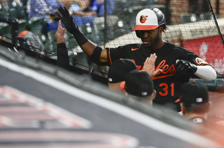 Sep 10, 2021; Baltimore, Maryland, USA; Baltimore Orioles center fielder Cedric Mullins (31) celebrates with teammates after hitting a first inning home run Toronto Blue Jays at Oriole Park at Camden Yards. Mandatory Credit: Tommy Gilligan-USA TODAY Sports
