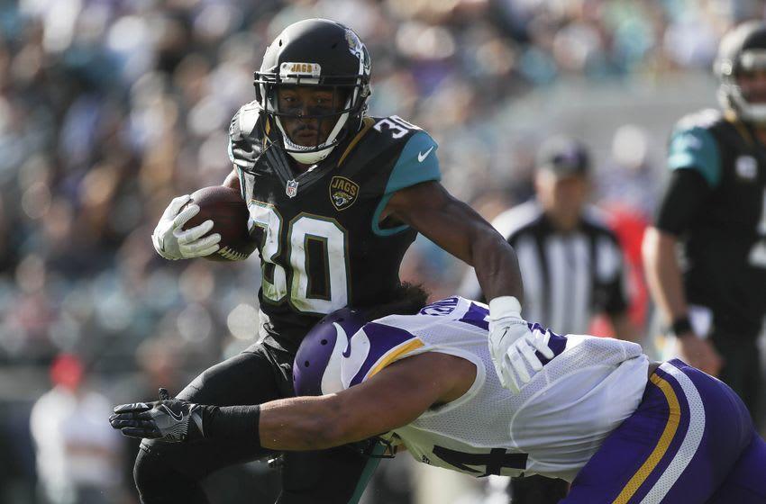 Dec 11, 2016; Jacksonville, FL, USA; Minnesota Vikings middle linebacker Eric Kendricks (54) tackles Jacksonville Jaguars running back Corey Grant (30) in the second half at EverBank Field. Mandatory Credit: Logan Bowles-USA TODAY Sports