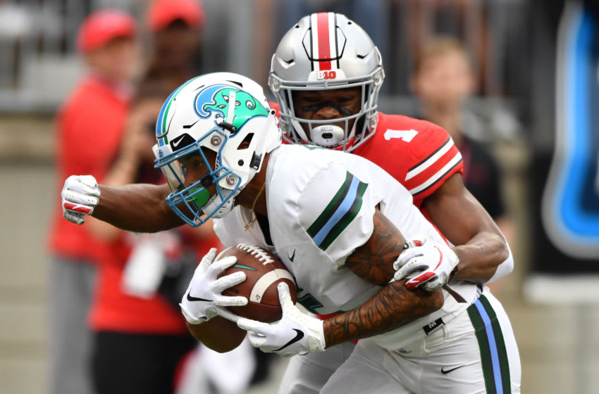 COLUMBUS, OH - SEPTEMBER 22: Terren Encalade #5 of the Tulane Green Wave catches a long pass in the second quarter as Jeffrey Okudah #1 of the Ohio State Buckeyes defends at Ohio Stadium on September 22, 2018 in Columbus, Ohio. (Photo by Jamie Sabau/Getty Images)
