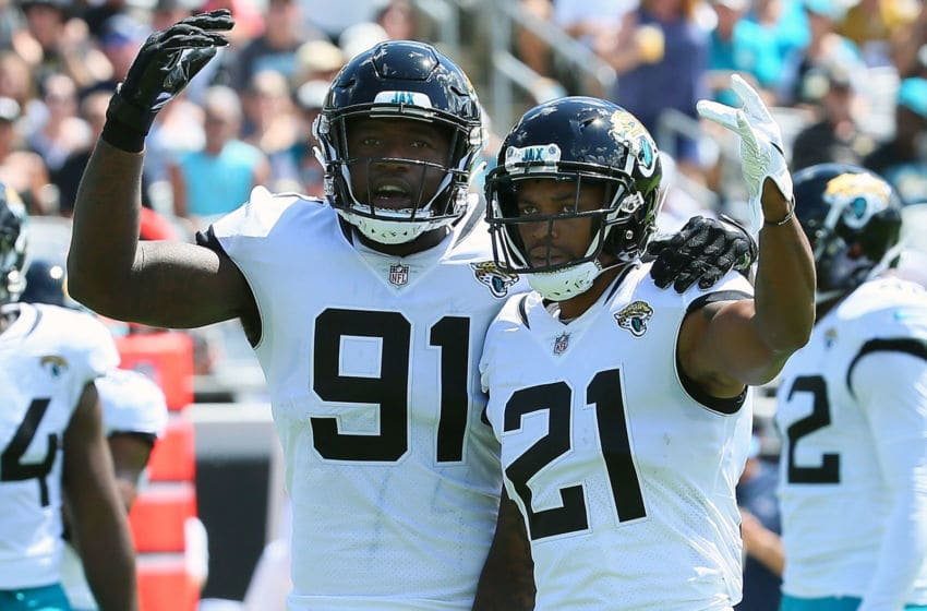 JACKSONVILLE, FL - SEPTEMBER 23: Yannick Ngakoue #91 and A.J. Bouye #21 of the Jacksonville Jaguars try to get the crowd to cheer against the Tennessee Titans at TIAA Bank Field on September 23, 2018 in Jacksonville, Florida. (Photo by Frederick Breedon/Getty Images)