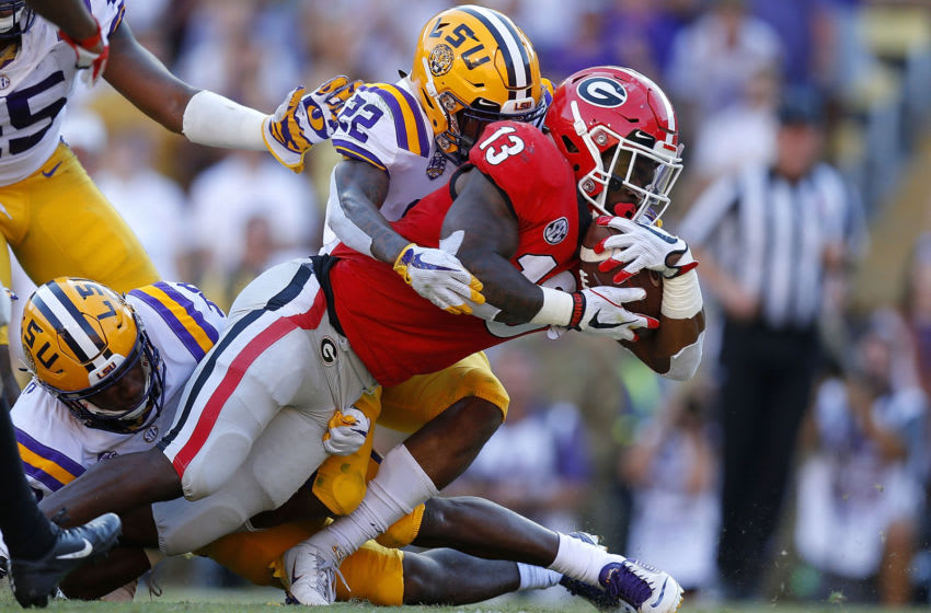 BATON ROUGE, LA - OCTOBER 13: Elijah Holyfield #13 of the Georgia Bulldogs scores a touchdown as Kristian Fulton #22 of the LSU Tigers defends during the second half at Tiger Stadium on October 13, 2018 in Baton Rouge, Louisiana. (Photo by Jonathan Bachman/Getty Images)