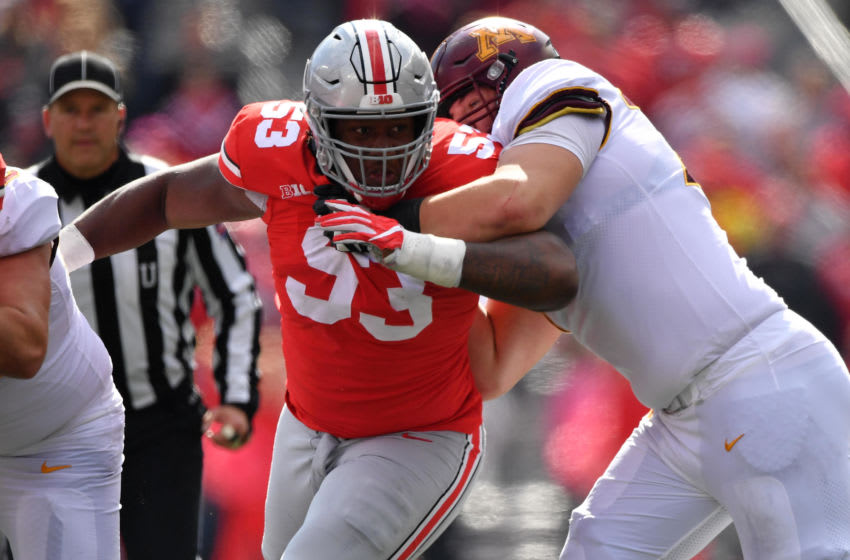 COLUMBUS, OH - OCTOBER 13: Davon Hamilton #53 of the Ohio State Buckeyes tracks the ballcarrier against the Minnesota Gophers at Ohio Stadium on October 13, 2018 in Columbus, Ohio. Ohio State defeated Minnesota 30-14. (Photo by Jamie Sabau/Getty Images)
