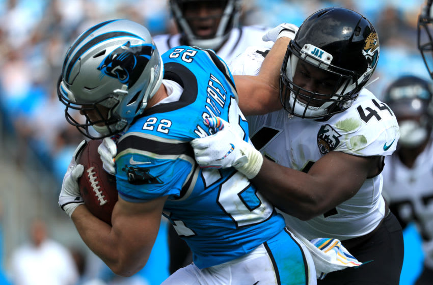 CHARLOTTE, NORTH CAROLINA - OCTOBER 06: Myles Jack #44 of the Jacksonville Jaguars tries to stop Christian McCaffrey #22 of the Carolina Panthers during their game at Bank of America Stadium on October 06, 2019 in Charlotte, North Carolina. (Photo by Streeter Lecka/Getty Images)