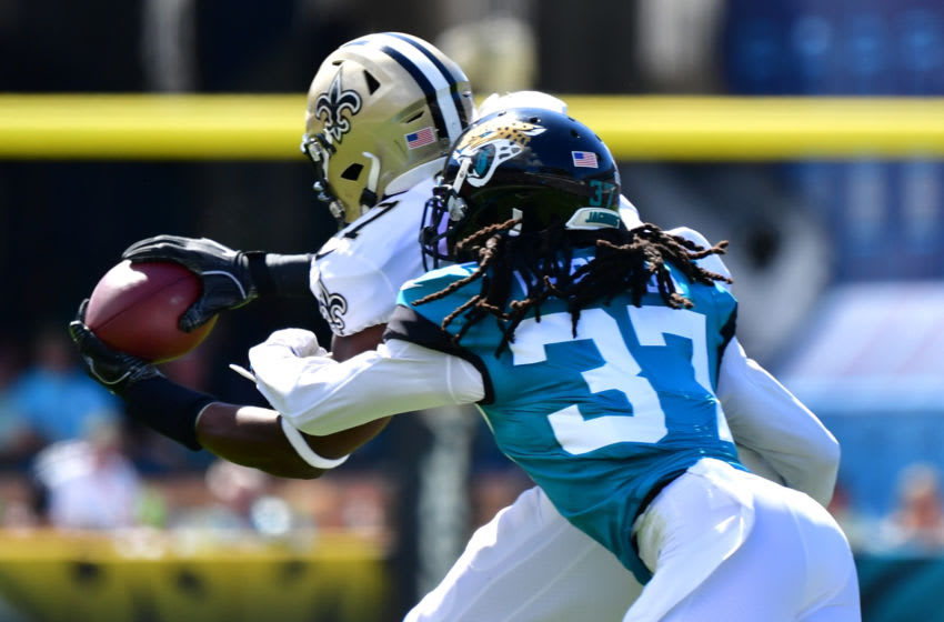 JACKSONVILLE, FLORIDA - OCTOBER 13: Tight end Jared Cook #87 of the New Orleans Saints gets the reception before cornerback Tre Herndon #37 of the Jacksonville Jaguars takes him down in the first quarter of the game at TIAA Bank Field on October 13, 2019 in Jacksonville, Florida. (Photo by Julio Aguilar/Getty Images)