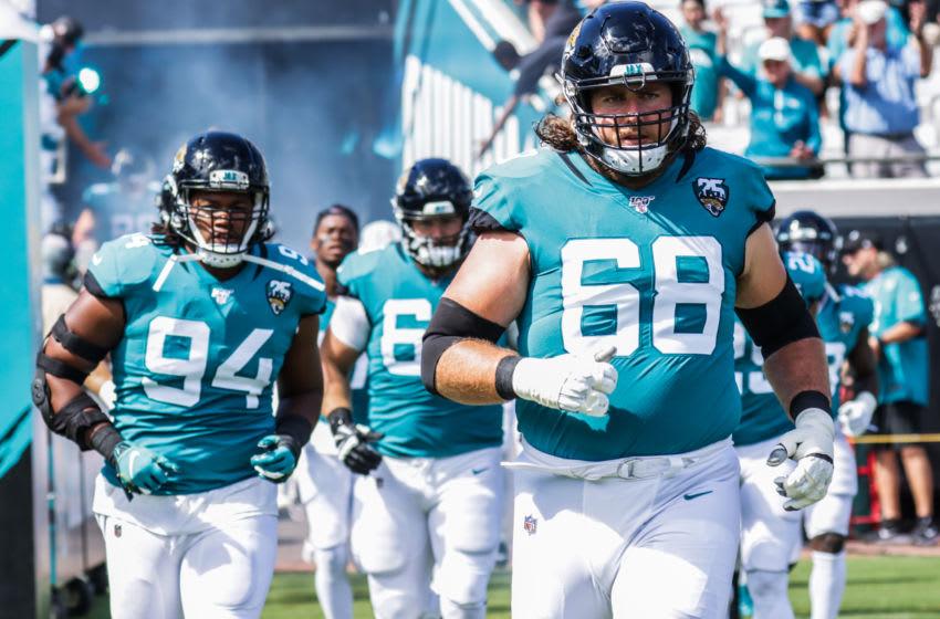 JACKSONVILLE, FLORIDA - OCTOBER 13: Andrew Norwell #68 of the Jacksonville Jaguars charges onto the field with his teammates before their game against the New Orleans Saints at TIAA Bank Field on October 13, 2019 in Jacksonville, Florida. (Photo by Harry Aaron/Getty Images)