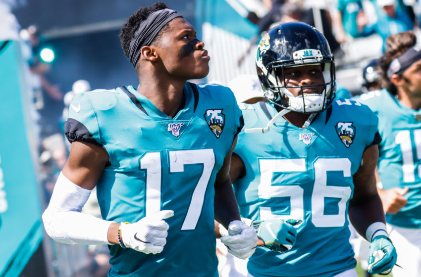 JACKSONVILLE, FLORIDA - OCTOBER 13: DJ Chark Jr. #17 and Quincy Williams #56 of the Jacksonville Jaguars charge onto the field before their team's game against the New Orleans Saints at TIAA Bank Field on October 13, 2019 in Jacksonville, Florida. (Photo by Harry Aaron/Getty Images)