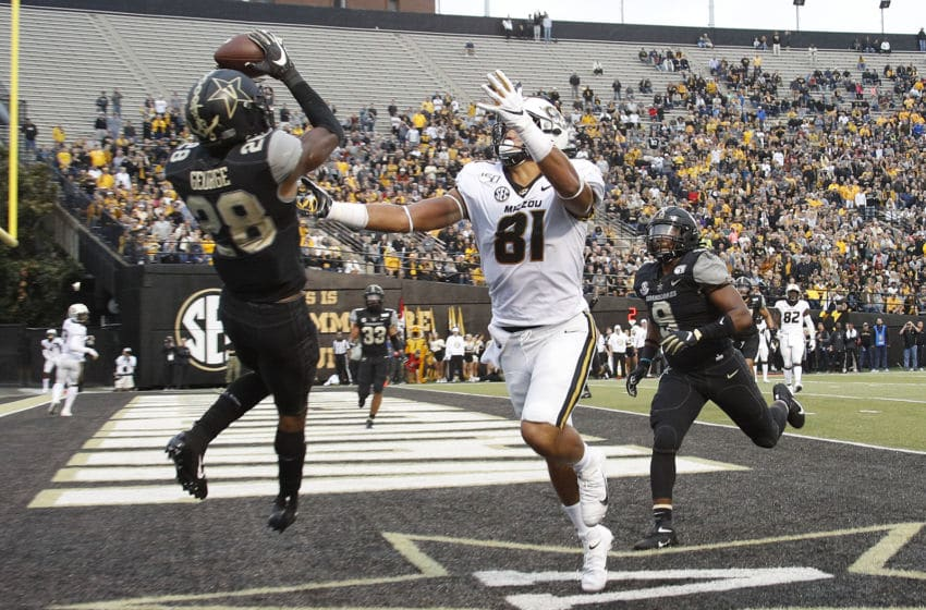 NASHVILLE, TENNESSEE - OCTOBER 19: Allan George #28 of the Vanderbilt Commodores makes an interception in the end zone over Albert Okwuegbunam #81 of the Missouri Tigers during the second half of a Vanderbilt 21-14 upset of the Missouri Tigers at Vanderbilt Stadium on October 19, 2019 in Nashville, Tennessee. (Photo by Frederick Breedon/Getty Images)