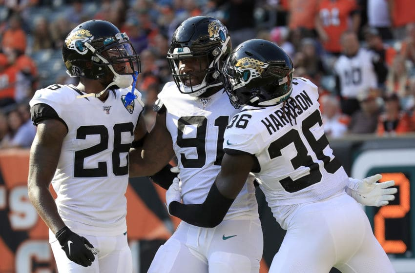 CINCINNATI, OHIO - OCTOBER 20: Jarrod Wilson #26, Yannick Ngakoue #91 and Ronnie harrison #36 of the Jacksonville Jaguars celebrate after Ngakoue returned an interception for a touchdown against the Cincinnati Bengals at Paul Brown Stadium on October 20, 2019 in Cincinnati, Ohio. (Photo by Andy Lyons/Getty Images)