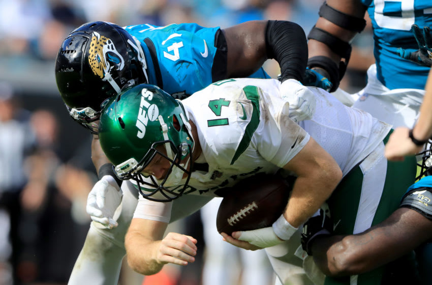 JACKSONVILLE, FLORIDA - OCTOBER 27: Sam Darnold #14 of the New York Jets is sacked by Josh Allen #41 of the Jacksonville Jaguars during the game at TIAA Bank Field on October 27, 2019 in Jacksonville, Florida. (Photo by Sam Greenwood/Getty Images)