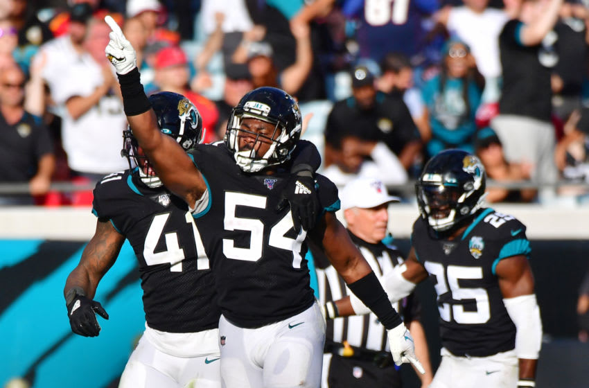 JACKSONVILLE, FLORIDA - DECEMBER 01: Donald Payne #54 of the Jacksonville Jaguars celebrates after a goal line stop during the fourth quarter of a football game against the Tampa Bay Buccaneers at TIAA Bank Field on December 01, 2019 in Jacksonville, Florida. (Photo by Julio Aguilar/Getty Images)