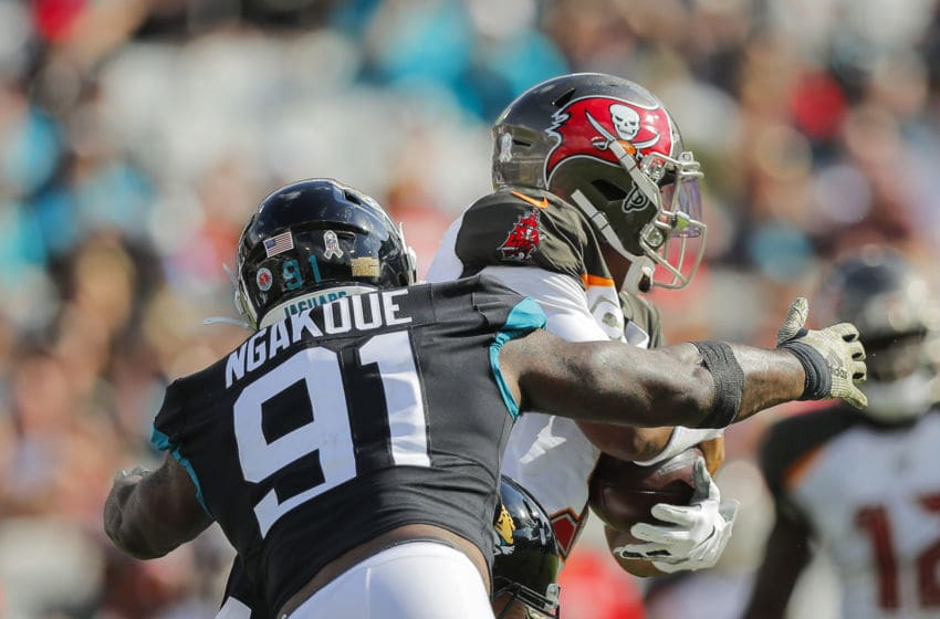 JACKSONVILLE, FLORIDA - DECEMBER 01: Yannick Ngakoue #91 of the Jacksonville Jaguars tackles Jameis Winston #3 of the Tampa Bay Buccaneers during the second quarter of a game at TIAA Bank Field on December 01, 2019 in Jacksonville, Florida. (Photo by James Gilbert/Getty Images)