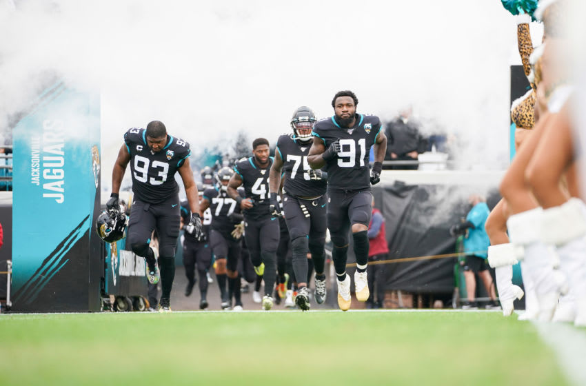 JACKSONVILLE, FLORIDA - DECEMBER 08: The Jacksonville Jaguars including Yannick Ngakoue #91 and Calais Campbell #93 enter the field before the start of a game against the Los Angeles Chargers at TIAA Bank Field on December 08, 2019 in Jacksonville, Florida. (Photo by James Gilbert/Getty Images)