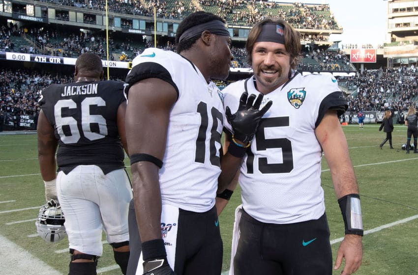 OAKLAND, CA - DECEMBER 15: Quarterback Gardner Minshew II #15 of the Jacksonville Jaguars celebrates with wide receiver Chris Conley #18 after the game against the Oakland Raiders at RingCentral Coliseum on December 15, 2019 in Oakland, California. The Jacksonville Jaguars defeated the Oakland Raiders 20-16. (Photo by Jason O. Watson/Getty Images)